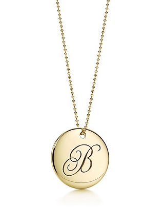 i am still loving initialed items and the gold version of tiffanys notes letter pendant would look great again tanfaux skin this summer