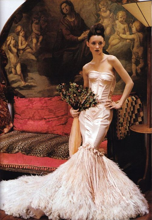 Jean Paul Gaultier 39s feathered wedding dress against a vibrant background